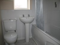White tiled bathroom in accomodation for let in Eccles
