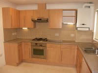 Modern wood kitchen in modern mews house for rent in Bury