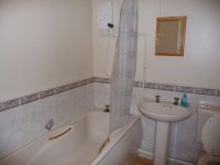 White tiled bathroom in Denton rental accommodation